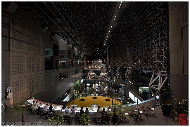 Kyoto Station atrium in the evening image copyright Damien Douxchamps
