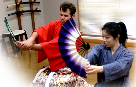 Master Auga Magari gives a lesson in dancing with a fan